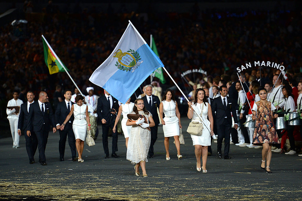 Alessandra Perilli of the San Marino Olympic shooting team carries her country's flag