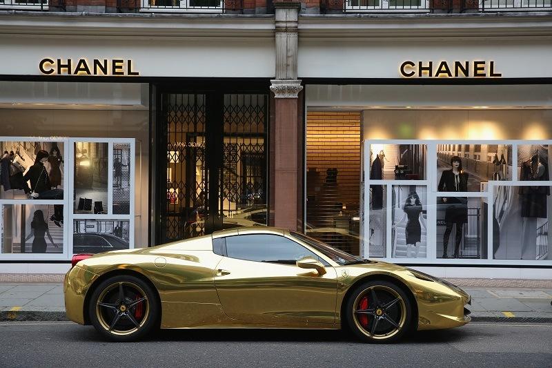 A gold Ferrari sits outside Chanel on Sloane Street in London