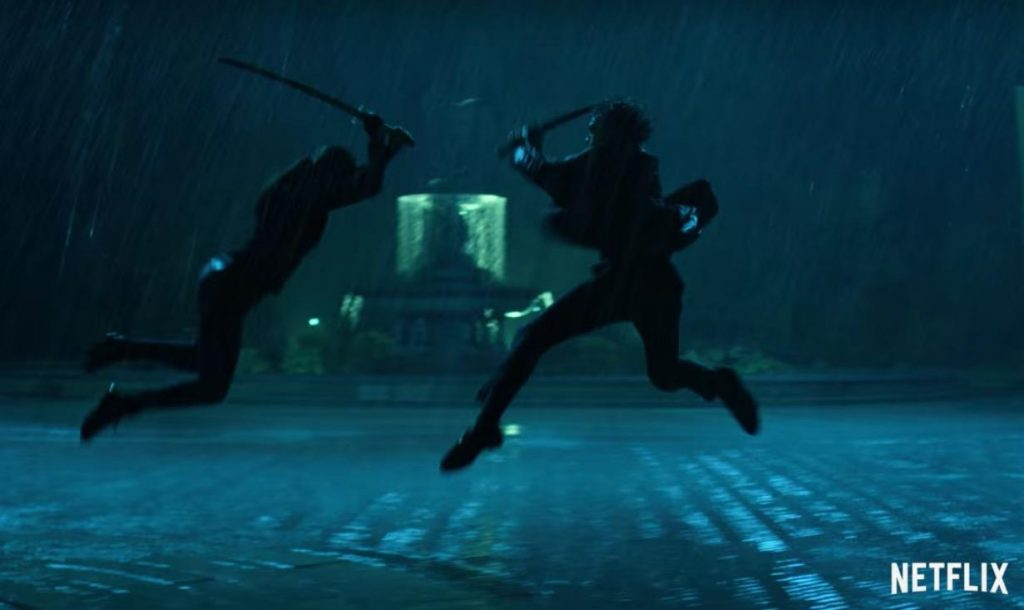 A silhouetted battle scene with two figures in a sword fight in Iron Fist