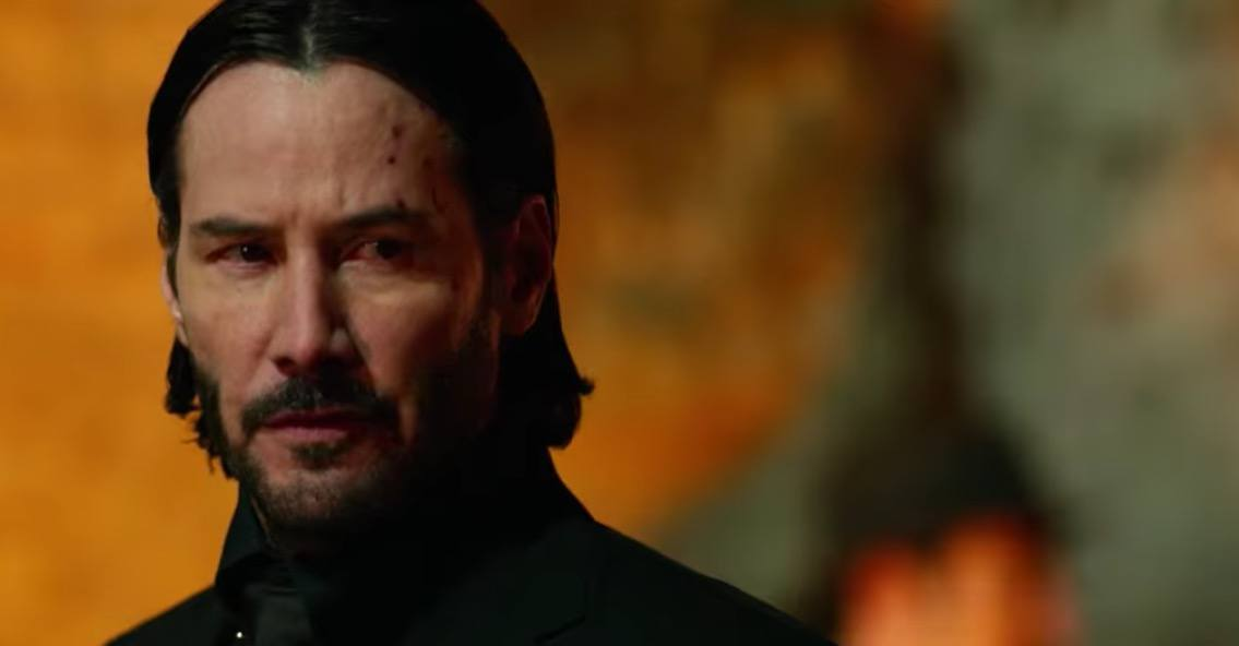 A close-up on John Wick, as he glances to the right of the frame