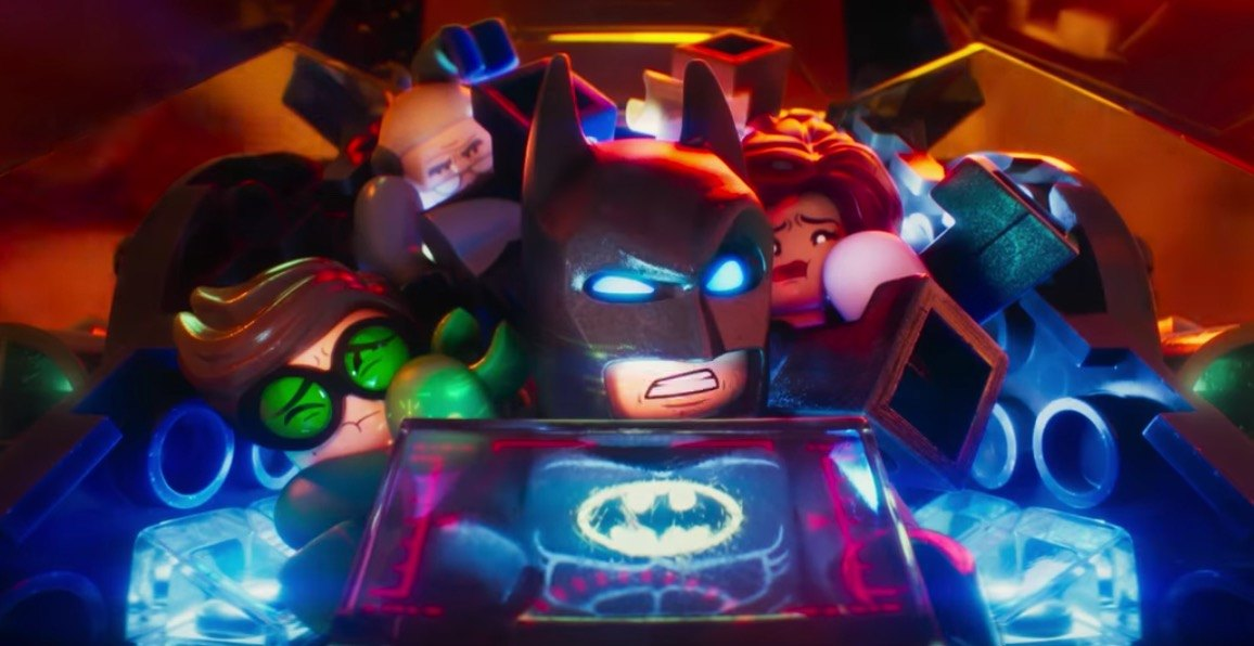 Lego Batman and his family crammed into a tiny cockpit of the Batmobile