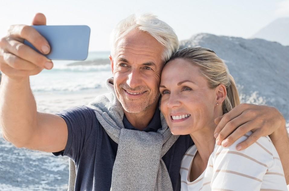 Happy romantic couple embracing on the beach