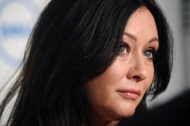 Actress Shannen Doherty smiling slightly and looking straight ahead.