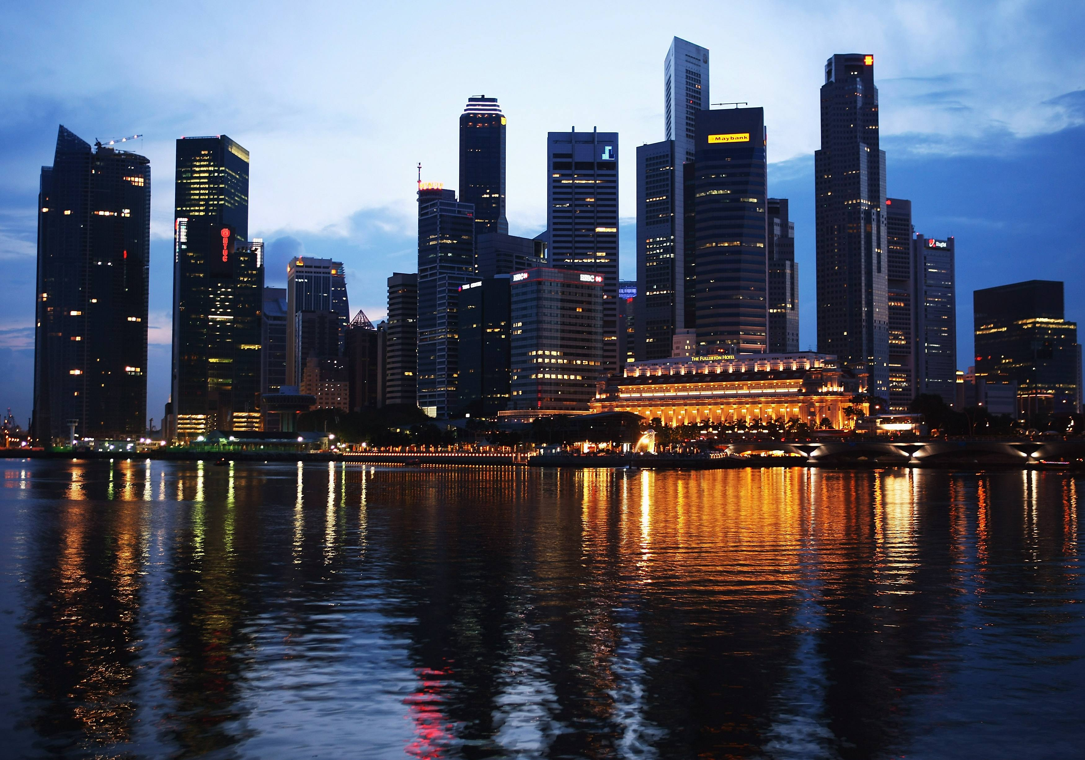 a view of singapore over the water at night