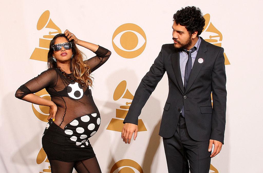 Singer M.I.A. (Maya Arulpragasam) (L) and Ben Brewer pose in the press room