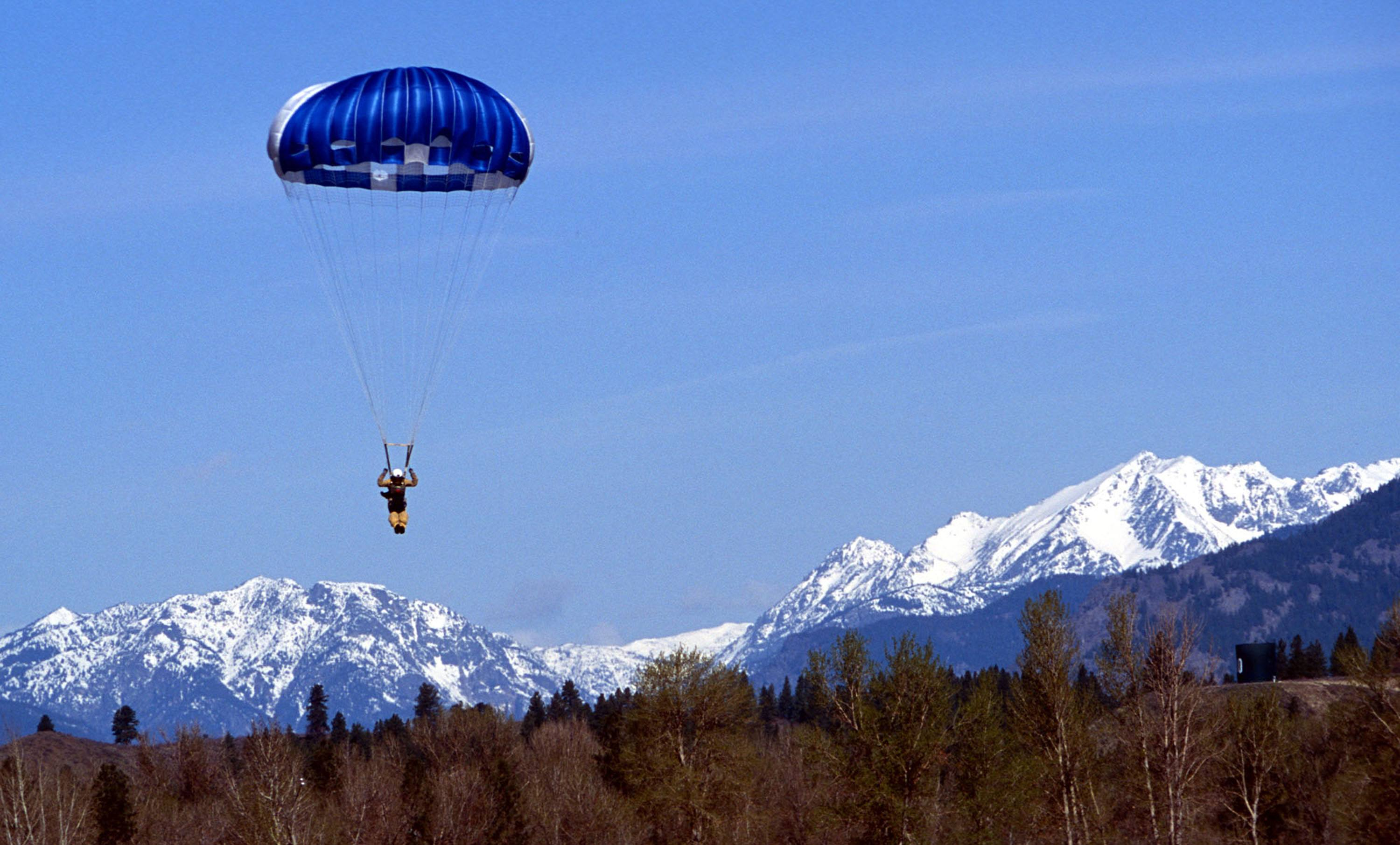 A smokejumper prepares to land at the airfield at the North Cascades Smokejumper Base in Washington