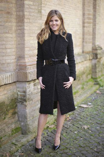 Italian actress Elisabetta Pellini wears Sarli coat on day 2 Rome Fashion Week