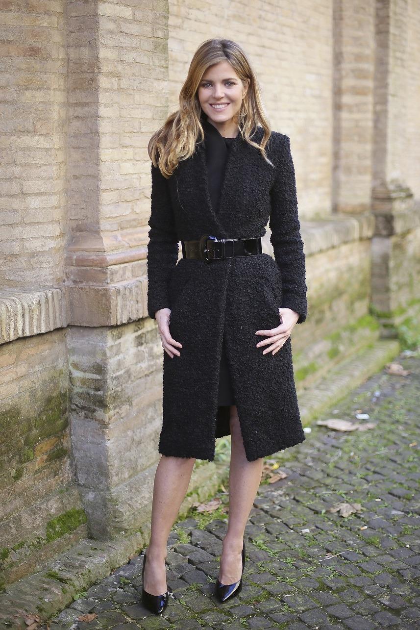 Italian actress Elisabetta Pellini wears Sarli coat on day 2 Rome Fashion Week