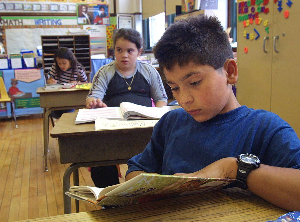 Students reading books in a classroom