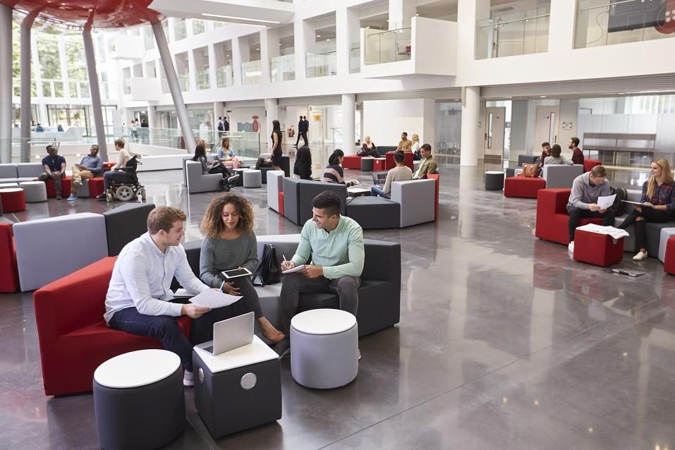 Students sitting in university atrium