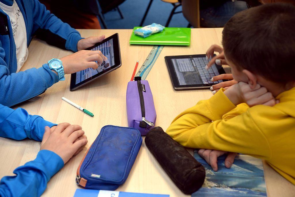 students working with tablets
