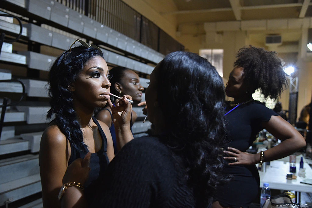 A model get her makeup applied backstage at The Gold and White Fashion Gala at Summer Sizzle British Virgin Islands