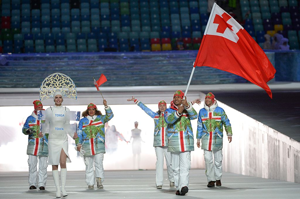 Tonga's flag bearer, luger Bruno Banani, leads his delegation