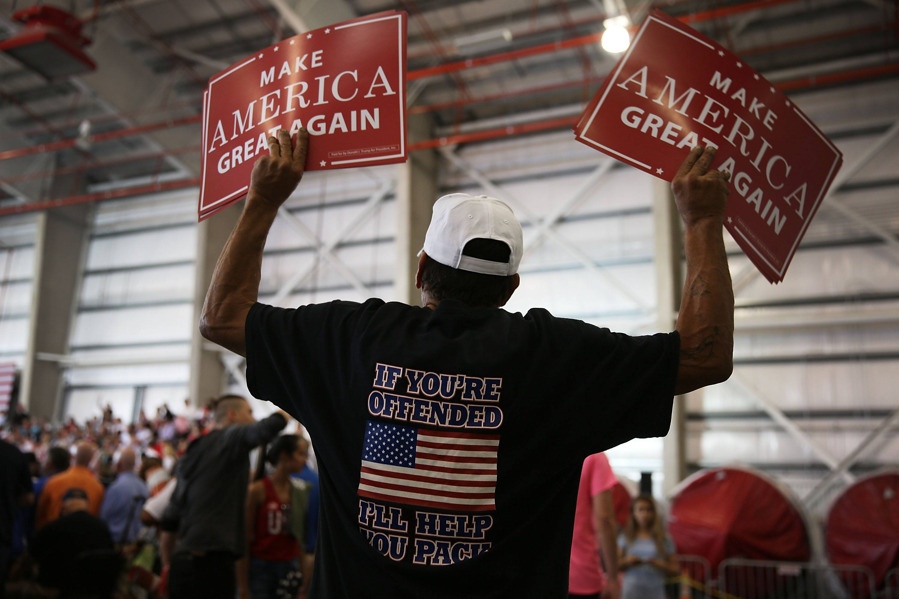 A Trump fan waits for the President at his Florida rally.