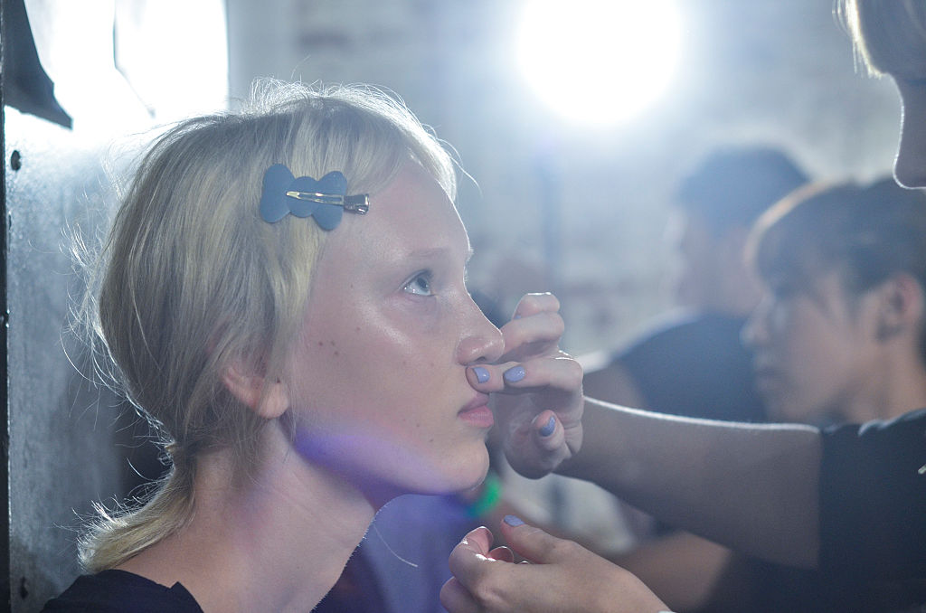 A model's make-up is done during the Ulla Johnson presentation at Skylight