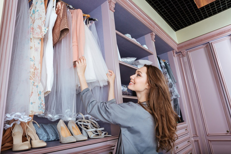 woman searching what to wear in a wardrobe