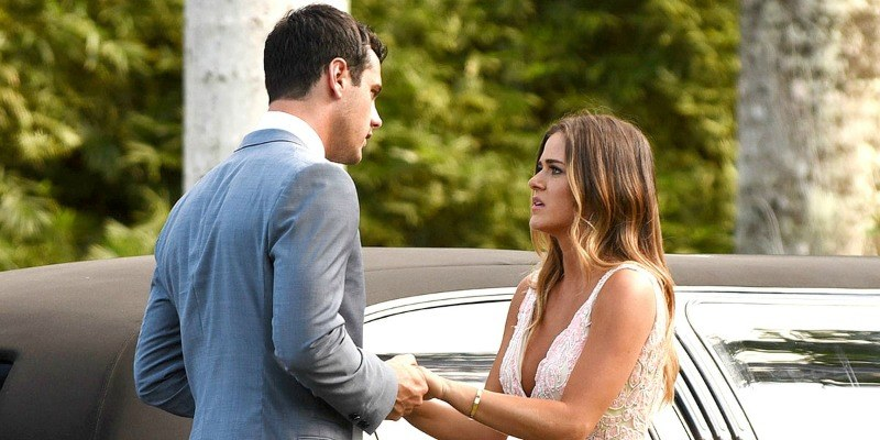 Ben is holding JoJo's hands as they stand next to a car on The Bachelor.