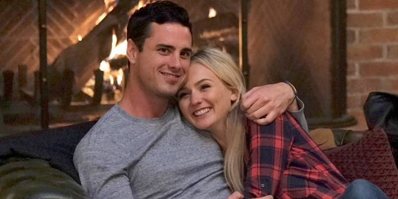 Ben Higgins and Lauren Bushnell are cuddling in front of a fire on The Bachelor