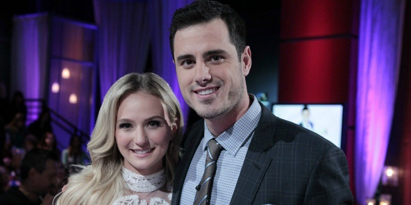 Ben Higgins and Lauren Bushnell are smiling next to each other.