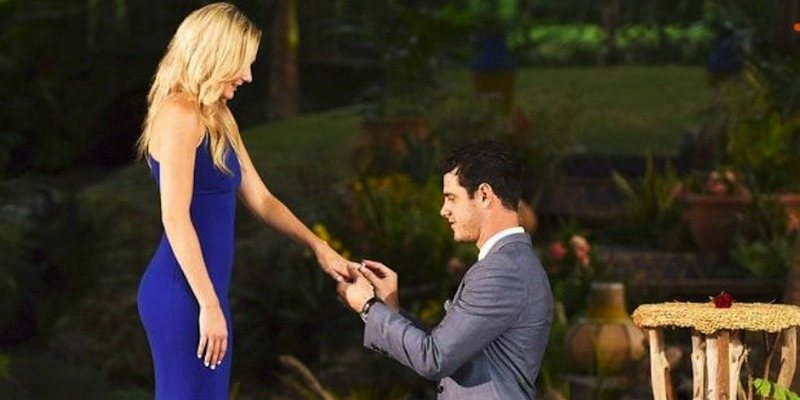 Ben is on one knee and is proposing to Lauren on The Bachelor.