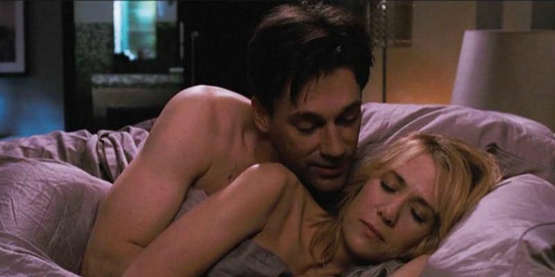 Jon Hamm is spooning Kristen Wiig in 'Bridesmaids.'