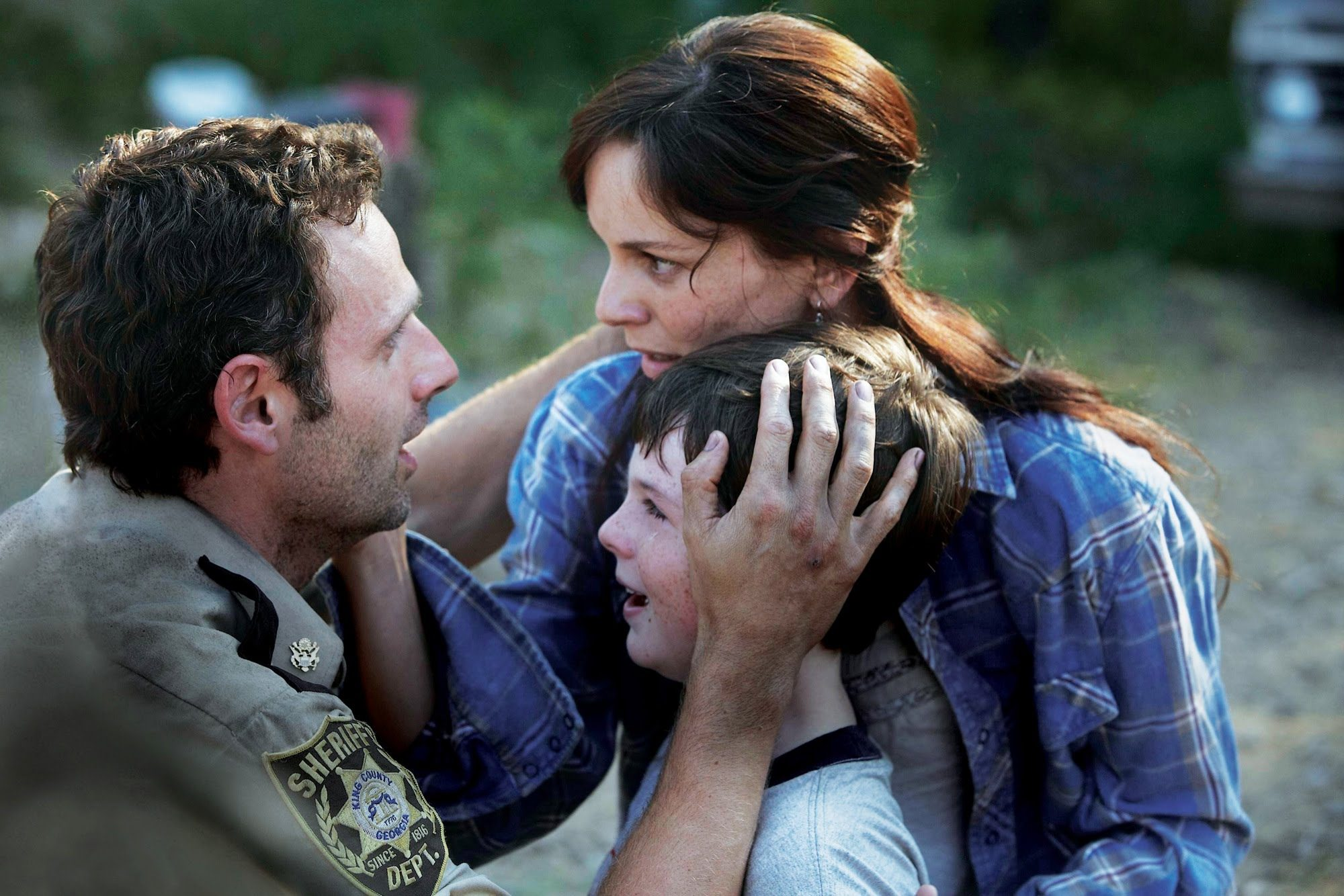 Carl is crying and Lori is shocking looking at Rick.