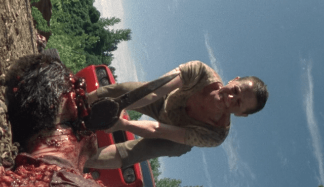 Carol putting an axe through Ed's head in 'The Walking Dead' episode 'Wildfire'