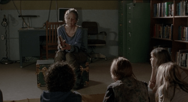 Carol sitting in front of the prison kids in 'The Walking Dead' episode '30 Days Without an Accident'