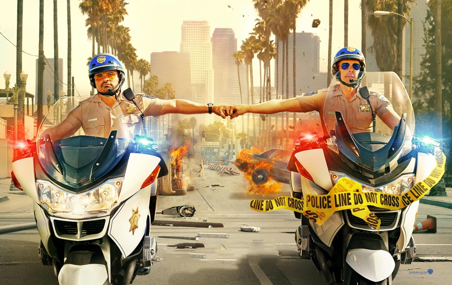 Michael Pena and Dax Sheperd bumping fists on motorcycles