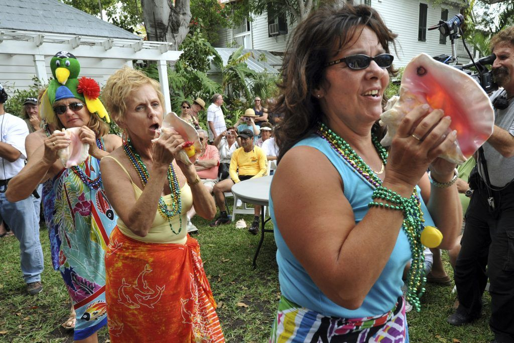 Key West, Florida residents blow conch shells