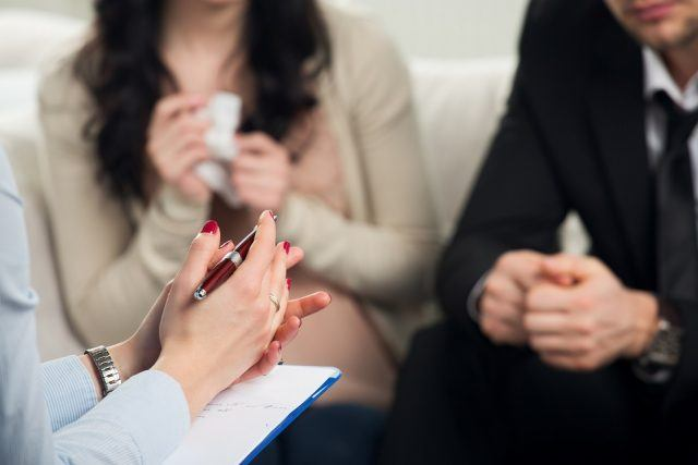 Couple with a problem consulting a psychologist.