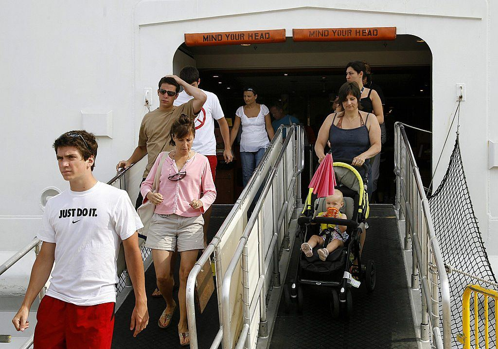 cruise ship passengers coming off the boat