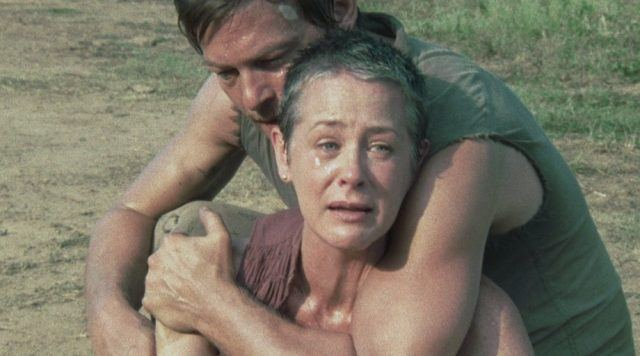Daryl embraces Carol as she cries at the sight of Sophia as a zombie in 'The Walking Dead' episode 'Pretty Much Dead Already'