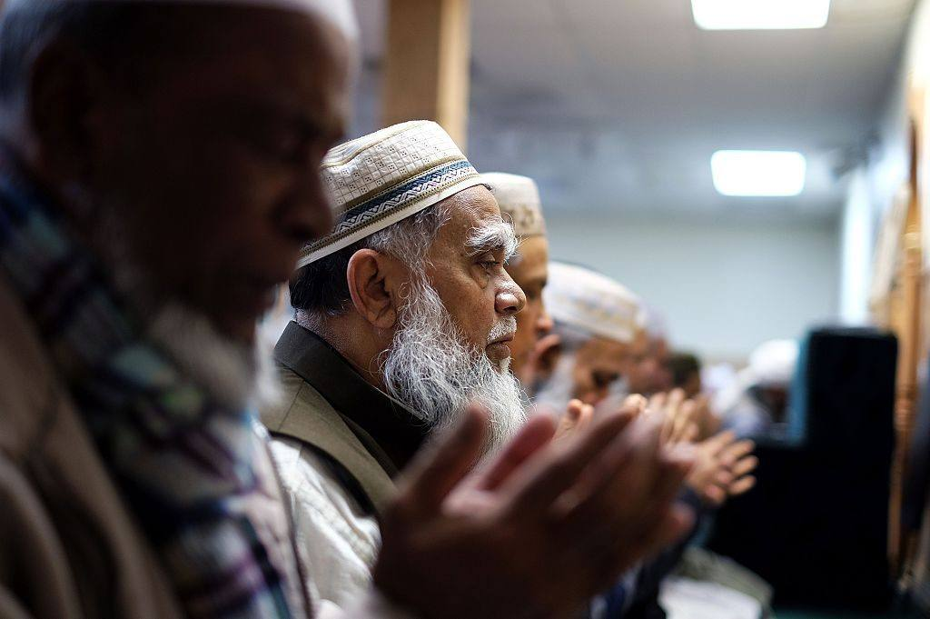 muslim men pray in a mosque