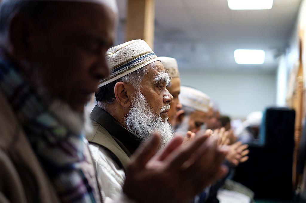 muslim men pray in a mosque