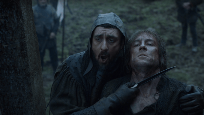 Edmure Tully struggles while a man holds a knife to his throat