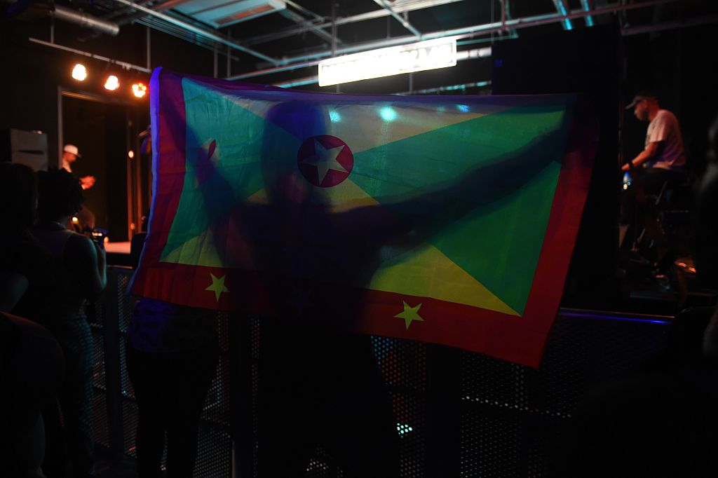 fan holding the flag of Grenada