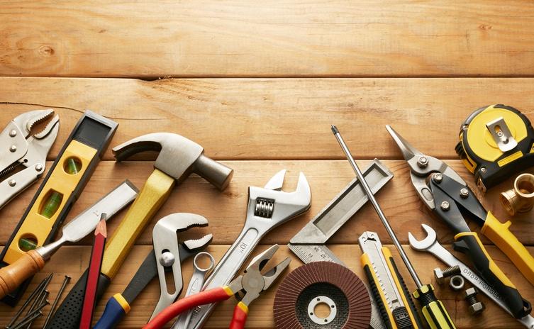Variety of tools on wood planks