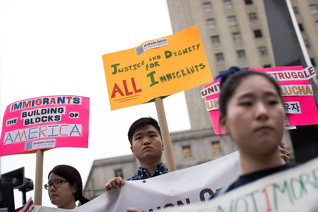 Members and supporters of the New York Immigration Coalition attend a rally for immigration reform