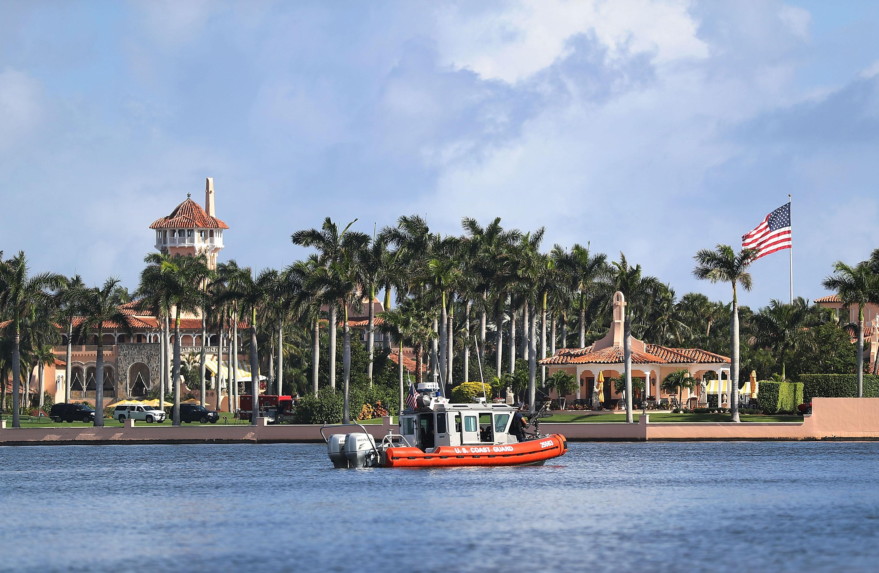 "A U.S. Coast Guard boat passes in front of the Mar-a-Lago Resort, President Donald Trump's ""winter White House."""