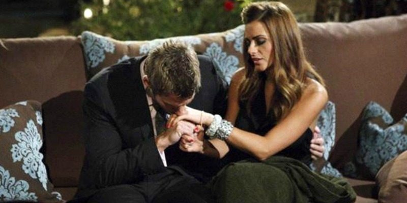 Brad Womack kissing Michelle Money's hand