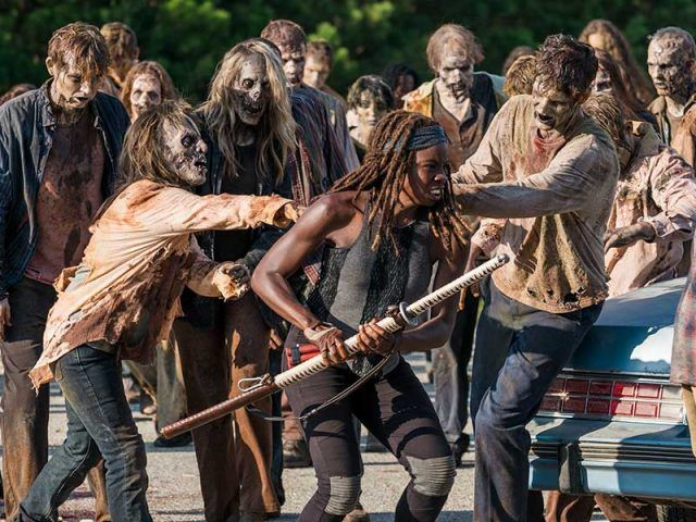 Michonne fighting off a hoard of walkers in a scene from 'The Walking Dead' episode 'The Rock in the Road'