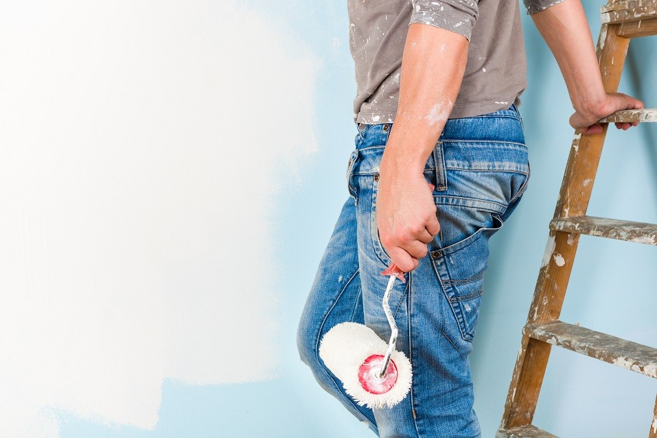 Painter in paint splattered shirt