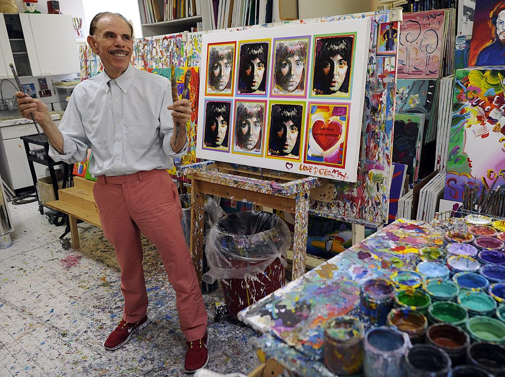 artist with paintings