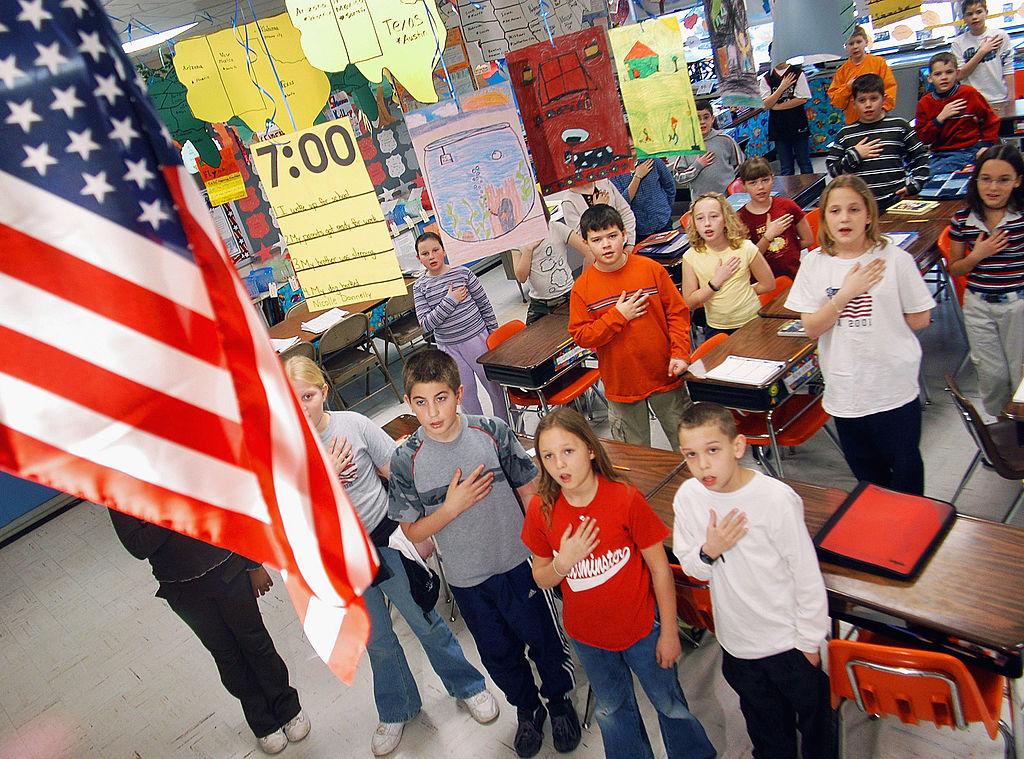 School children pledge allegiance to the flag