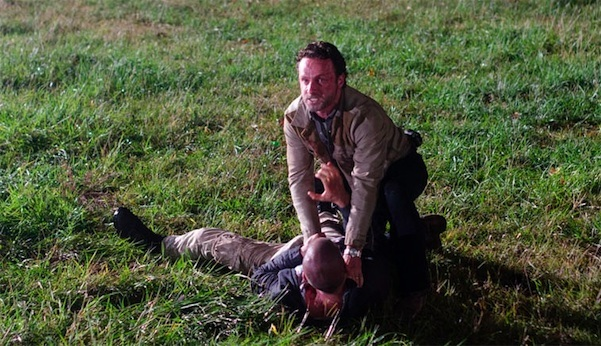 Rick holds Shane down on the ground in a scene from 'The Walking Dead' episode 'Better Angels'