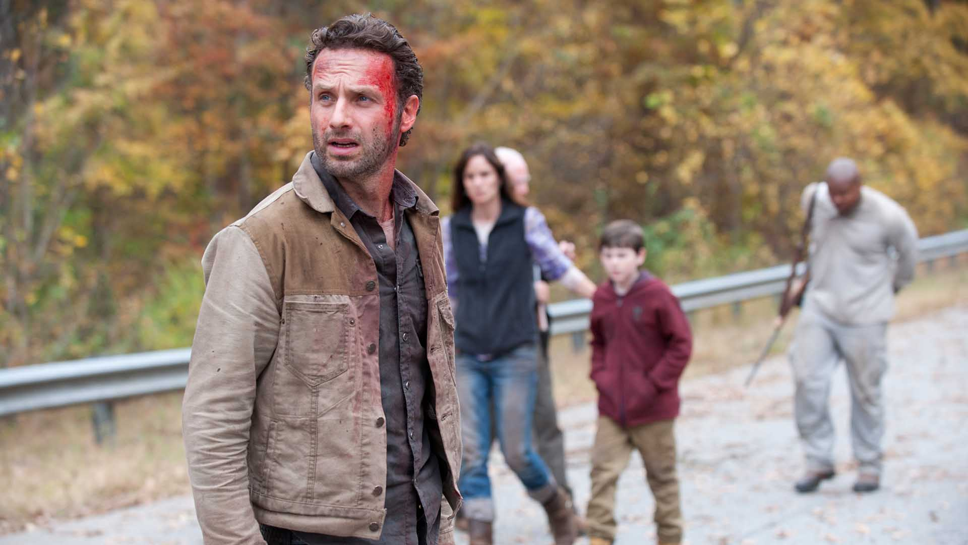 Rick stands with a bloodied forehead