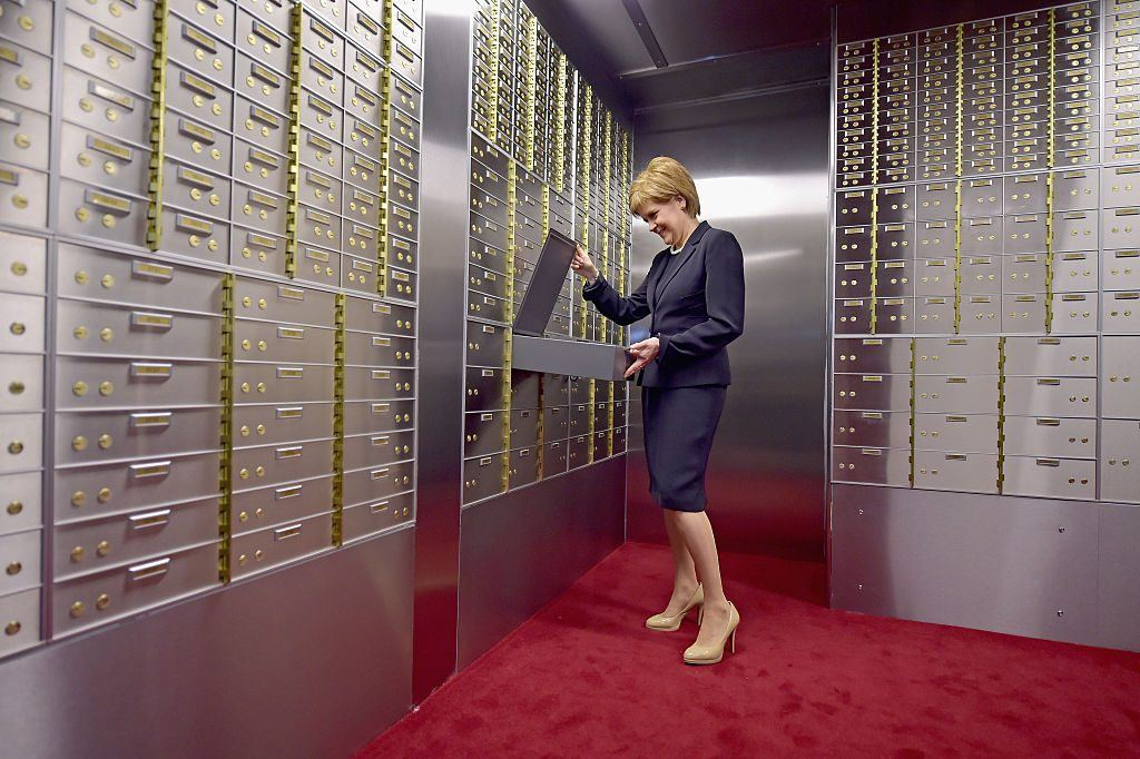 First Minister Nicola Sturgeon of Scotland opens a safe deposit box
