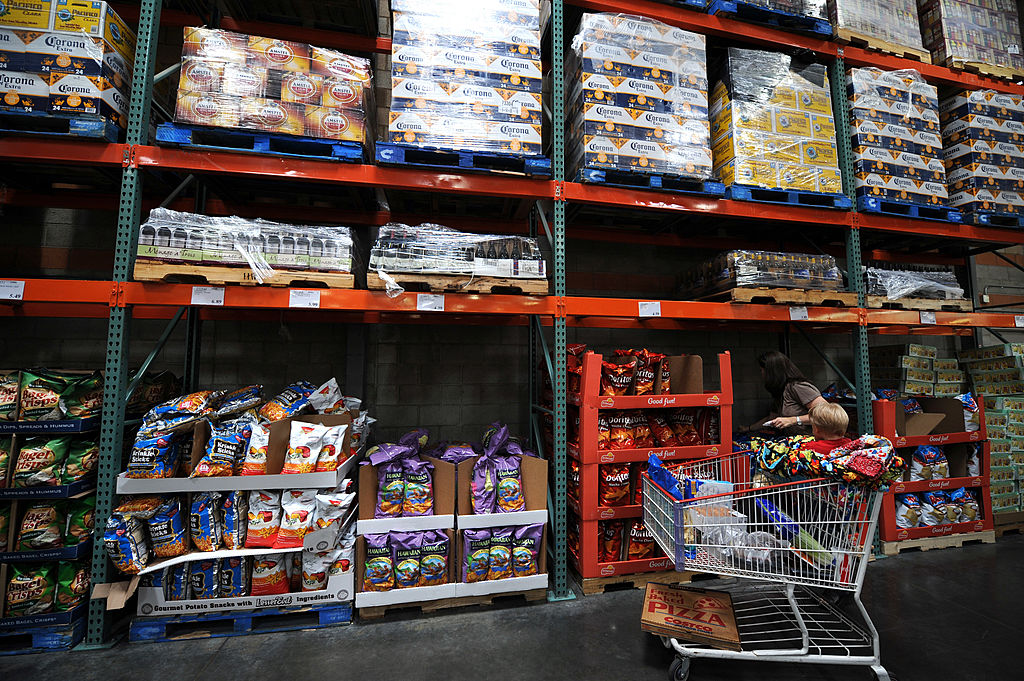 "A woman shops at the low cost, high volume Costco supermarket warehouse -- the opposite of the ""buy nothing"" lifestyle"