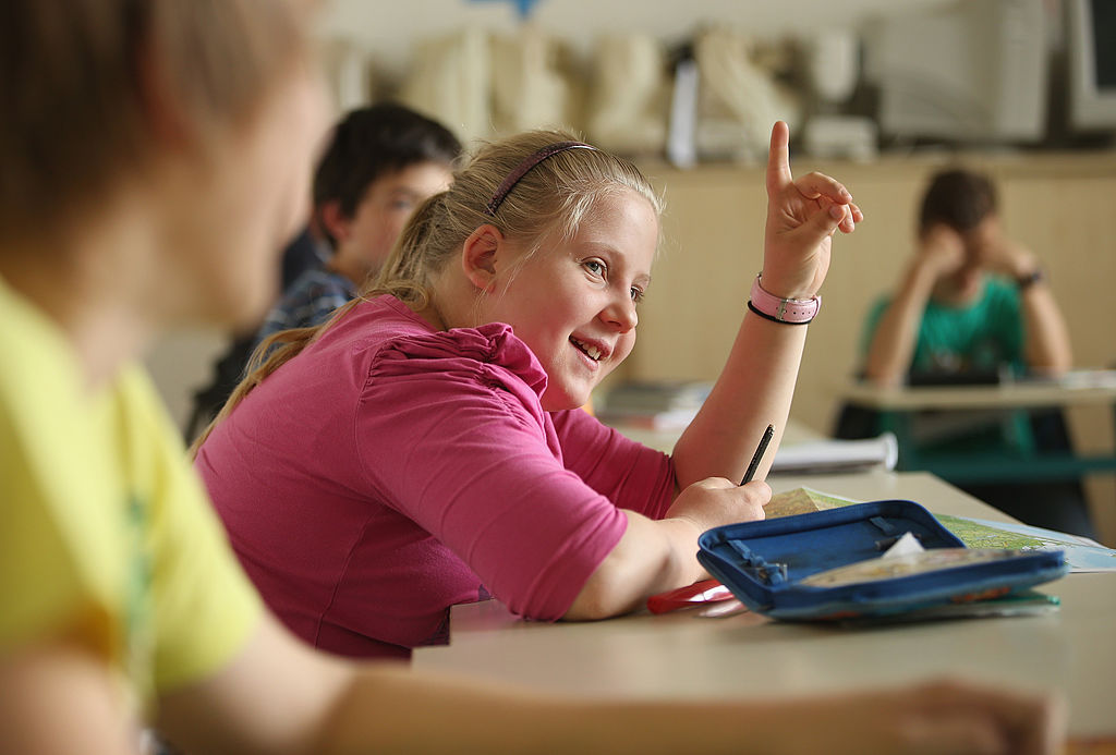 a student raises her hand